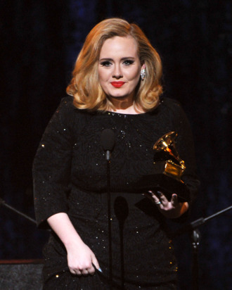 LOS ANGELES, CA - FEBRUARY 12: Singer Adele accepts the Best Pop Solo Performance Aweard for