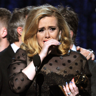 LOS ANGELES, CA - FEBRUARY 12: Singer Adele accepts the Album of the Year Award for