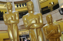 """Oscar statues at the Kodak Theatre, which is the site of the Sundays 83rd Academy Awards in Hollywood, on February 26, 2011.  Hollywood is bracing for the climax of its annual awards season this weekend, with British drama """"The King's Speech"""" and Facebook film """"The Social Network"""" battling neck-and-neck for top Oscars glory. Tinsel Town's glittering stars will descend on the red carpet Sunday for the 83rd Academy Awards, the ultimate accolade for filmmakers and performers in the multi-billion-dollar movie industry. Other films in the running for some of the top gongs include hi-tech blockbuster """"Inception,"""" western remake """"True Grit"""" and sexually-charged ballet thriller """"Black Swan.""""                           AFP PHOTO / Mark RALSTON (Photo credit should read MARK RALSTON/AFP/Getty Images)"""