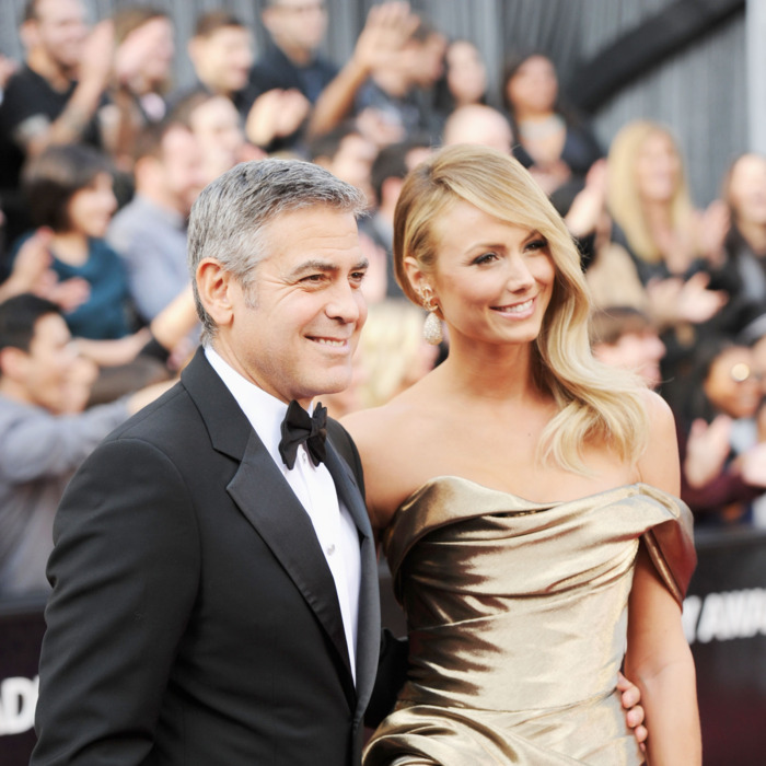 Actor George Clooney (L) and Stacy Kiebler arrive at the 84th Annual Academy Awards