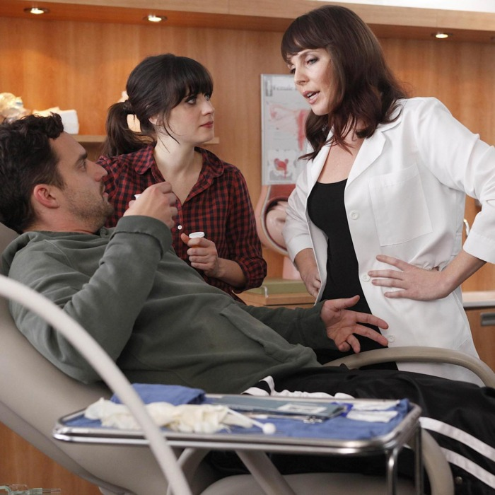 NEW GIRL: When Nick (Jake Johnson, L) is hurt playing touch football, Jess (Zooey Deschanel, C) discovers he doesn't have insurance and brings him to her friend (guest star June Diane Raphael, R) who is an OB-GYN in the