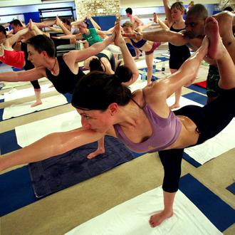 Students practice the unique Bikram Yoga at the City Studio