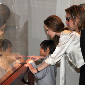 Art patrons and supporters, Angelina Jolie, Brad Pitt, and their son, Pax view works from LACMA's Chinese collection