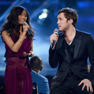 LOS ANGELES, CA - MAY 23: Finalists Jessica Sanchez (L) and Phillip Phillips perform onstage during Fox's