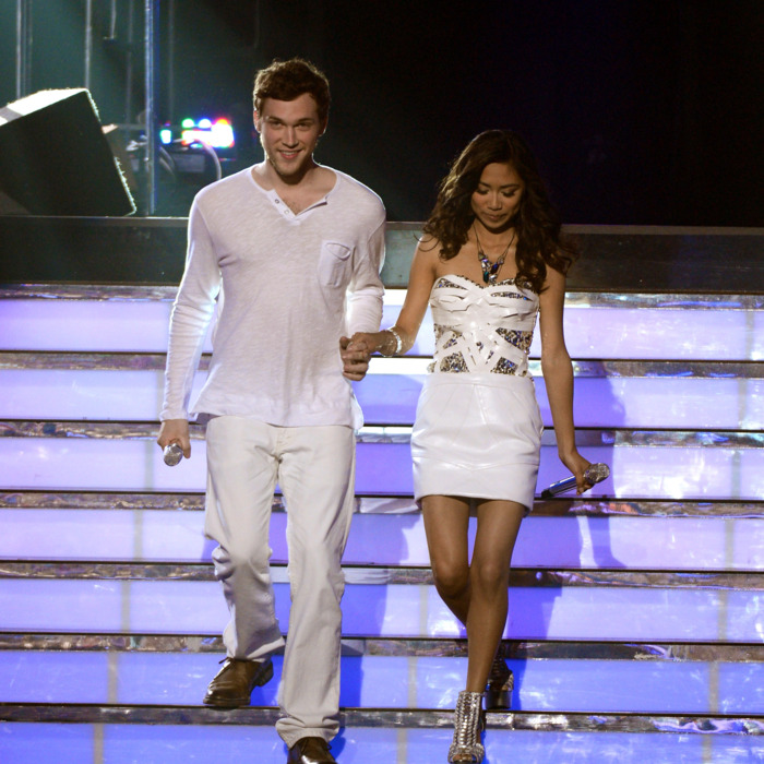 Finalists Phillip Phillips and Jessica Sanchez walk onstage during Fox's