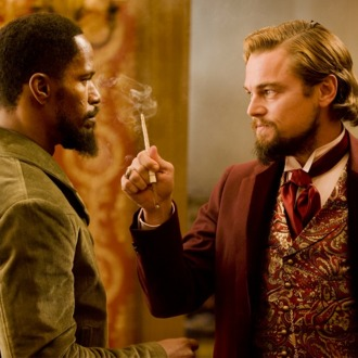 Jamie Foxx, left, and Leonardo DiCaprio in Columbia Pictures'