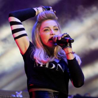 Madonna introduces Avicii as part of Day Two of Ultra Music Festival 14 at Bayfront Park on March 24, 2012 in Miami, Florida.