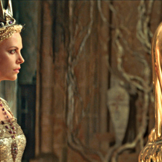 The Queen (CHARLIZE THERON) consults with the Mirror Man in the epic action-adventure