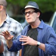 Charlie Sheen gets annoyed as a Staples Center employee reportedly refused to let him back in the Stadium after he and his friends stepped outside for a smoke break during Game 4 of the Stanley Cup Finals at the Staples Center in Los Angeles, CA.