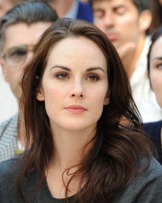 Actress Michelle Dockery attend the Burberry Prorsum show as part of Milan Fashion Week Menswear Spring/Summer 2013 on June 23, 2012 in Milan, Italy.