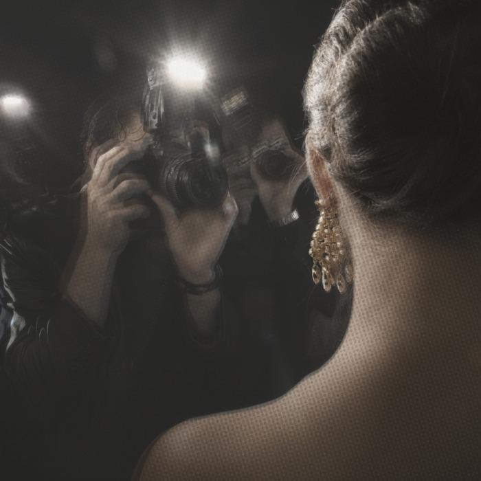 Paparazzi Photographing Celebrity