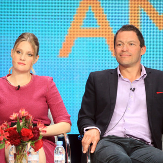 Actress Romola Garai (L) and actor Dominic West speak at the