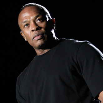 Rapper Dr. Dre performs onstage during day 3 of the 2012 Coachella Valley Music & Arts Festival at the Empire Polo Field on April 15, 2012 in Indio, California.