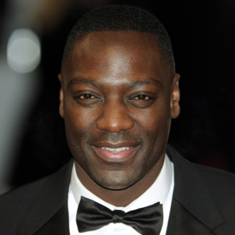 British actor Adewale Akinnuoye-Agbaje poses on the red carpet arriving at the BAFTA British Academy Film Awards at the Royal Opera House in London on February 12, 2012.