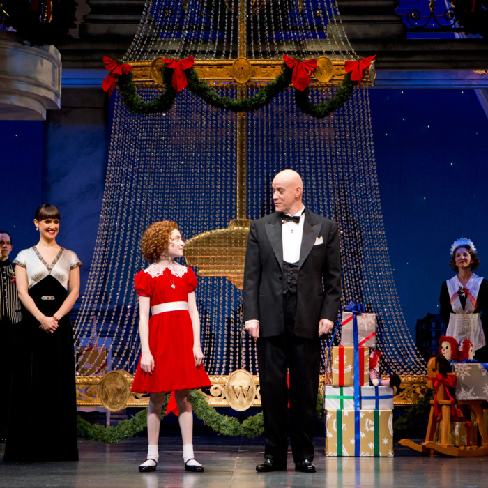 (l-r) Brynn O'Malley (Grace Farrell), Lilla Crawford (Annie), Anthony Warlow (Oliver Warbucks) and Ensemble in ANNIE at the Palace Theatre (Broadway at 47th Street). ANNIE features a book by Thomas Meehan, music by Charles Strouse and lyrics by Martin Charnin. The production is choreographed by Andy Blankenbuehler and directed by James Lapine.