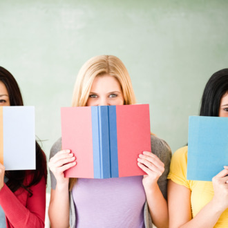 Women hiding behind books