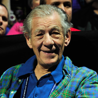 British actor Ian Mckellen watches Switzerland's Roger Federer play against Argentina's Juan Martin Del Potro during their group B singles match in the round robin stage on the sixth day of the ATP World Tour Finals tennis tournament in London on November 10, 2012.