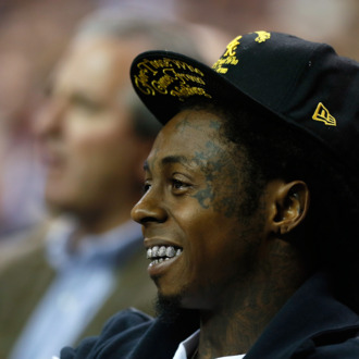 ATLANTA, GA - NOVEMBER 13: Rapper Lil Wayne watches the game between the Duke Blue Devils and the Kentucky Wildcats during the 2012 State Farm Champions Classic at Georgia Dome on November 13, 2012 in Atlanta, Georgia. (Photo by Kevin C. Cox/Getty Images)