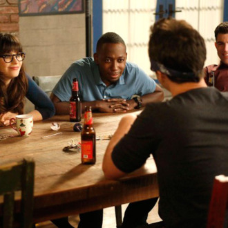 NEW GIRL: L-R: Jess (Zooey Deschanel), Winston (Lamorne Morris) and Schmidt (Max Greenfield) watch as Nick plays Feely-Cup in the