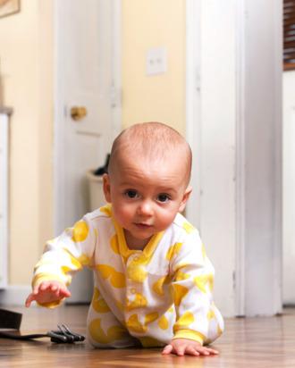 Portrait of a baby boy crawling