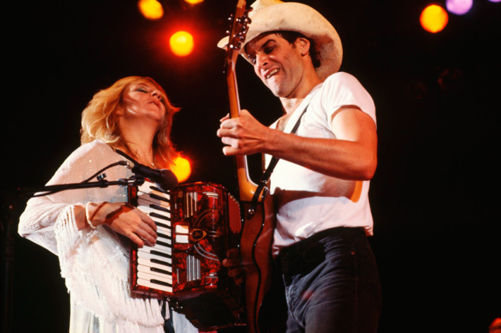 August 31 or September 1, 1980 --- Christine McVie and Lindsey Buckingham perform on stage during a concert.