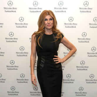 Actress Connie Britton poses backstage at the Monique Lhuillier Fall 2013 fashion show during Mercedes-Benz Fashion Week at The Theatre at Lincoln Center on February 9, 2013 in New York City.