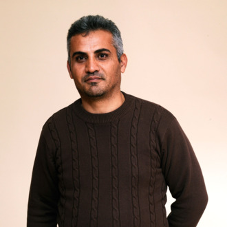 Director Emad Burnat poses for a portrait during the 2012 Sundance Film Festival at the Getty Images Portrait Studio at T-Mobile Village at the Lift on January 20, 2012 in Park City, Utah.