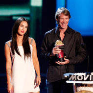 """UNIVERSAL CITY, CA - JUNE 01:  Actress Megan Fox (L) and director Michael Bay accept the award for Best Movie for """"Transformers"""" during the 17th annual MTV Movie Awards held at the Gibson Amphitheatre on June 1, 2008 in Universal City, California.  (Photo by Kevin Winter/Getty Images)"""