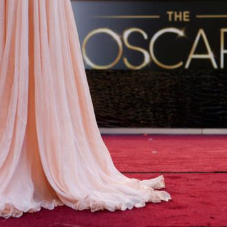 Antonella Michelena, a television reporter from Mexico, is silhouetted as she reports from the red carpet outside the Dolby Theatre in the Hollywood section of Los Angeles, Friday, Feb. 22, 2013 as preparations for this Sunday's 85th Academy Awards continue.