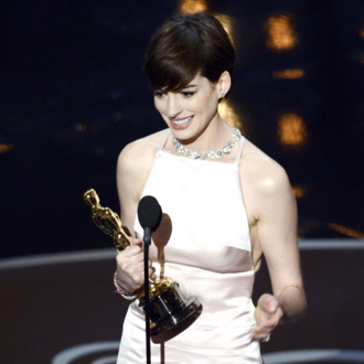 Actress Anne Hathaway accepts the Best Supporting Actress award for