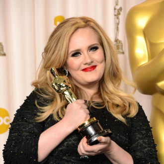 Singer Adele, winner of the Best Original Song award for