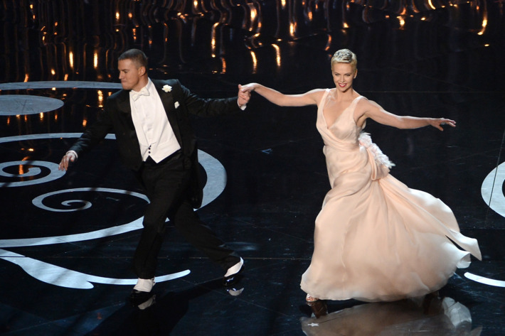 HOLLYWOOD, CA - FEBRUARY 24:  Actor Channing Tatum and actress Charlize Theron dance onstage during the Oscars held at the Dolby Theatre on February 24, 2013 in Hollywood, California.  (Photo by Kevin Winter/Getty Images)