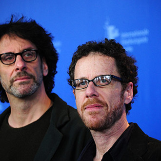 (from L) US film-making brothers Joel Coen and Ethan Coen pose for photographers during a photocall for their movie