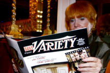 "A women reads a magazines at the Variety Magazine's ""Women In Showbiz"" at the Beverly Hills Hotel on November 16, 2004 in Beverly Hills California."