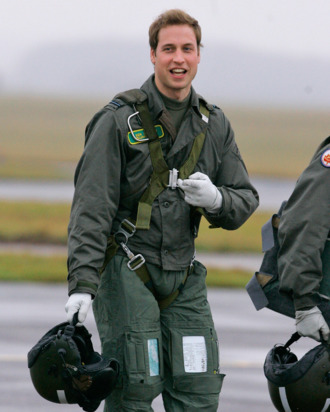 Britain's Prince William gestures as he walks across the airfield at RAF Cranwell, Lincolnshire, England, Thursday, Jan. 17, 2008. The prince, an army officer with the Household Cavalry's Blues and Royals, is two weeks into a four-month attachment with the RAF to help William, get to grips with the service's ethos, traditions and military role. The prince's father, Prince Charles, completed his flying training course at RAF Cranwell from March to August in 1971 and graduated that year as a Flight Lieutenant. While training with 1 Squadron of 1 Elementary Flying Training School, he will fly a propeller driven Grob 115E light aircraft, known as the Tutor. If successful he will move to 1 Flying Training School where he will get to grips with the faster Tucano T1 plane and finally progress to fly the Squirrel helicopter.