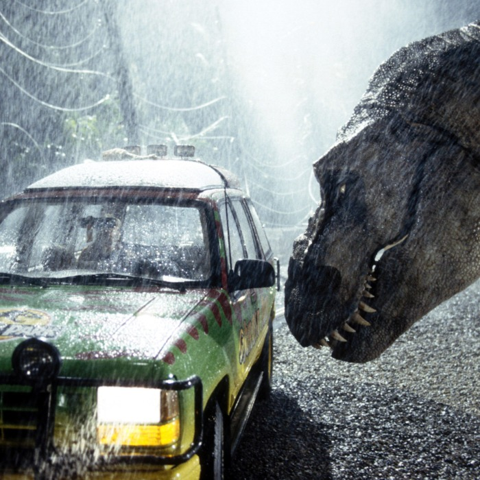 A tyrannosaurus rex terrorizes people trapped in a car in a scene from the 1993 American film Jurassic Park directed by Steven Spielberg. The sci-fi adventure stars Sam Neill, Laura Dern, and Jeff Goldblum. The film is an adaptation of Michael Crichton's novel of the same name.