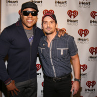 LAS VEGAS, NV - SEPTEMBER 22:  Actor/rapper LL Cool J (L) and recording artist Brad Paisley appear backstage during the 2012 iHeartRadio Music Festival at the MGM Grand Garden Arena on September 22, 2012 in Las Vegas, Nevada.  (Photo by Christopher Polk/Getty Images for Clear Channel)