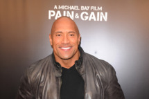"""MIAMI BEACH, FL - APRIL 11: Dwayne Johnson attends the """"Pain & Gain"""" premiere on April 11, 2013 in Miami Beach, Florida. (Photo by Larry Marano/Getty Images)"""
