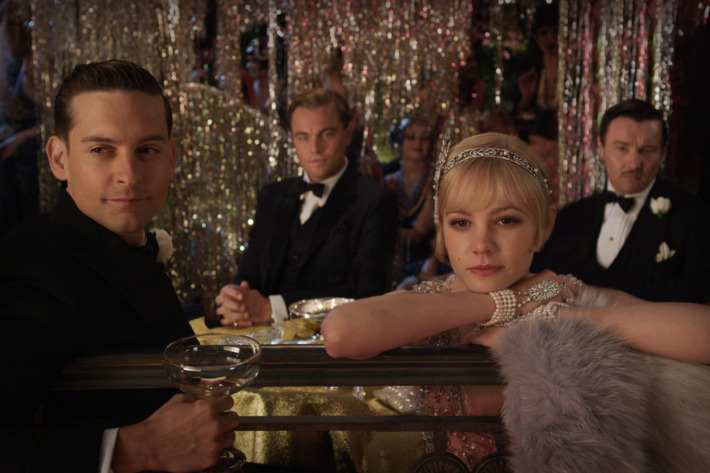 """(L-r) TOBEY MAGUIRE as Nick Carraway, LEONARDO DICAPRIO as Jay Gatsby, CAREY MULLIGAN as Daisy Buchanan and JOEL EDGERTON as Tom Buchanan in Warner Bros. Pictures' and Village Roadshow Pictures' drama """"THE GREAT GATSBY,"""" a Warner Bros. Pictures release."""