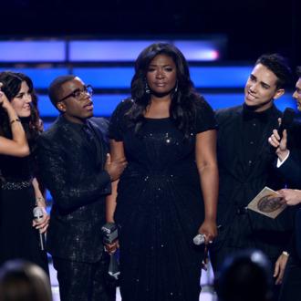 American Idol Season 12 Winner Candice Glover (C) speaks onstage during Fox's