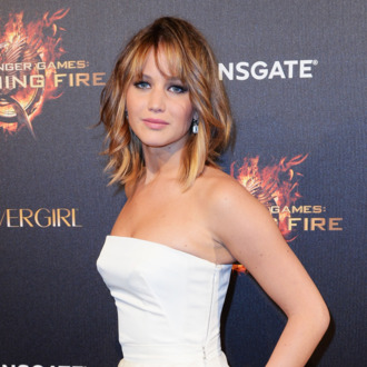 CANNES, FRANCE - MAY 18: Actress Jennifer Lawrence attends 'The Hunger Games: Catching Fire' Party during The 66th Annual Cannes Film Festival at Baoli Beach on May 18, 2013 in Cannes, France. (Photo by Samir Hussein/Getty Images)