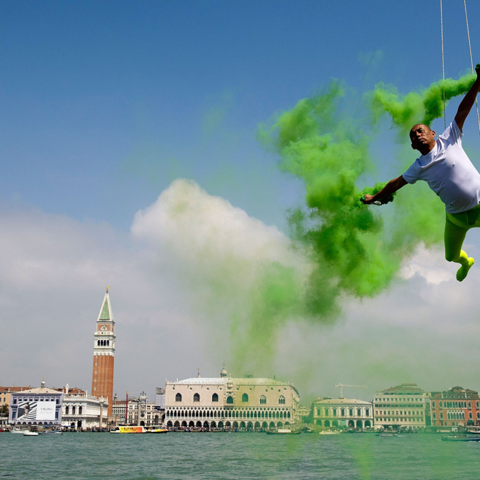Chinese artist Li Wei performs in front of Saint's Mark as part of the 55th International Art Exhibition on May 28, 2013 in Venice, Italy. The 55th International Art Exhibition of La Biennale di Venezia will be open to the public from the June 1 - November 24, 2013.