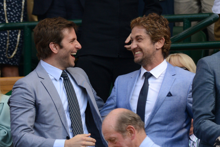 Bradley Cooper and Gerard Butler attend the Mens Singles Final on Day 13 of the Wimbledon Lawn Tennis Championships at the All England Lawn Tennis and Croquet Club on July 7, 2013 in London, England.