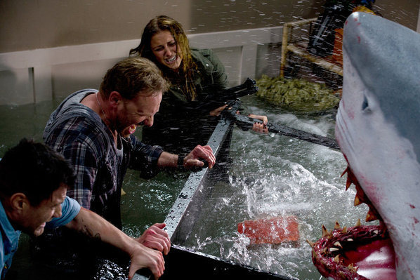 "SHARKNADO -- ""Syfy Original Movie"" -- Pictured: (l-r) Ian Ziering as Fin, Cassie Scerbo as Nova -- (Photo by: Syfy)"