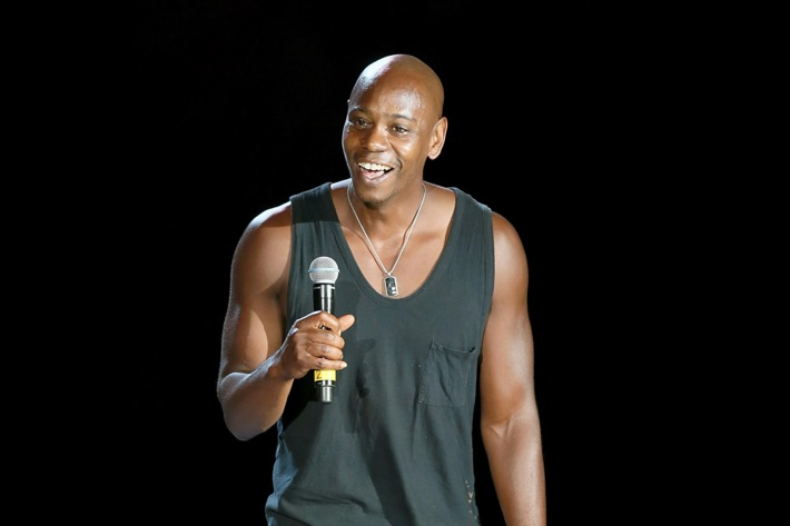 Dave Chappelle performs on stage during the first night of the Oddball Comedy & Curiosity Festival Tour at Austin360 Amphitheater on August 23, 2013 in Austin, Texas.