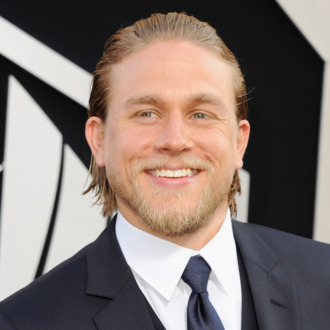 HOLLYWOOD, CA - JULY 09: Actor Charlie Hunnam arrives at the Los Angeles Premiere