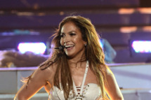 """LOS ANGELES, CA - MAY 16:  Singer Jennifer Lopez performs onstage during Fox's """"American Idol 2013"""" Finale Results Show at Nokia Theatre L.A. Live on May 16, 2013 in Los Angeles, California.  (Photo by Kevin Winter/Getty Images)"""