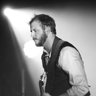 SYDNEY, AUSTRALIA - MARCH 11: (EDITORS NOTE: Image has been converted to black and white.) Justin Vernon of Bon Iver performs on stage at the Sydney Opera House on March 11, 2012 in Sydney, Australia. (Photo by Mark Metcalfe/Getty Images)