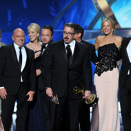"""Vince Gilligan, center, and the cast and crew of """"Breaking Bad"""" accept the award for outstanding drama series at the 65th Primetime Emmy Awards at Nokia Theatre on Sunday Sept. 22, 2013, in Los Angeles.  (Photo by Vince Bucci/Invision for Academy of Television Arts & Sciences/AP Images)"""