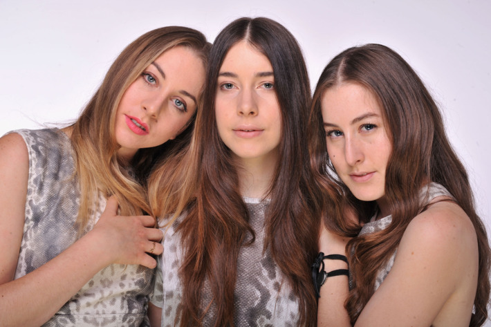 """LONDON, ENGLAND - JUNE 01:  (EXCLUSIVE COVERAGE. HIGHER RATES APPLY) (L-R) Alana Haim, Danielle Haim and Este Haim of HAIM pose for a portrait backstage at the """"Chime For Change: The Sound Of Change Live"""" Concert at Twickenham Stadium on June 1, 2013 in London, England. Chime For Change is a global campaign for girls' and women's empowerment founded by Gucci with a founding committee comprised of Gucci Creative Director Frida Giannini, Salma Hayek Pinault and Beyonce Knowles-Carter.  (Photo by Mick Hutson/Chime For Change/Getty Images for Gucci)"""